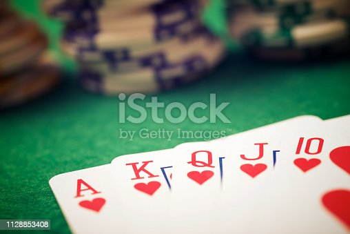 view of a gaming table with green mat