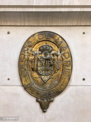 Madrid, Spain - February 23, 2020: Bronze plaque at the entrance of the Casino de Madrid. It is located in the city downtown and it was born as a social club in 1836. It was declared a site of cultural interest in 1993