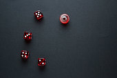 five dices on the black background and ones still spinning
