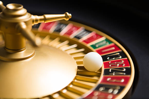 casino roulette wheel with the ball on number 36 casino roulette wheel with the ball on number 36 game of chance stock pictures, royalty-free photos & images