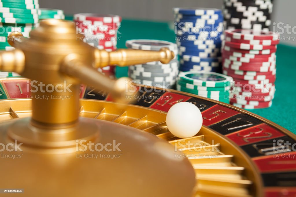 casino roulette wheel with the ball on number 5 stock photo