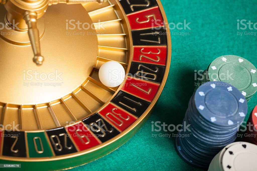casino roulette wheel with the ball on number 7 stock photo