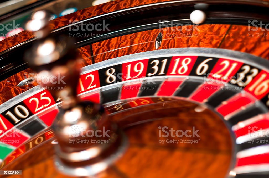 Casino roulette with both the wheel and the ball spinning stock photo