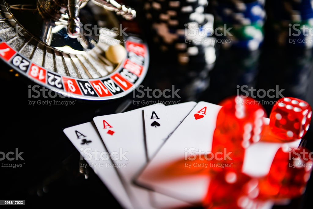 Casino theme. high contrast image of casino roulette, playing chips and dice stock photo