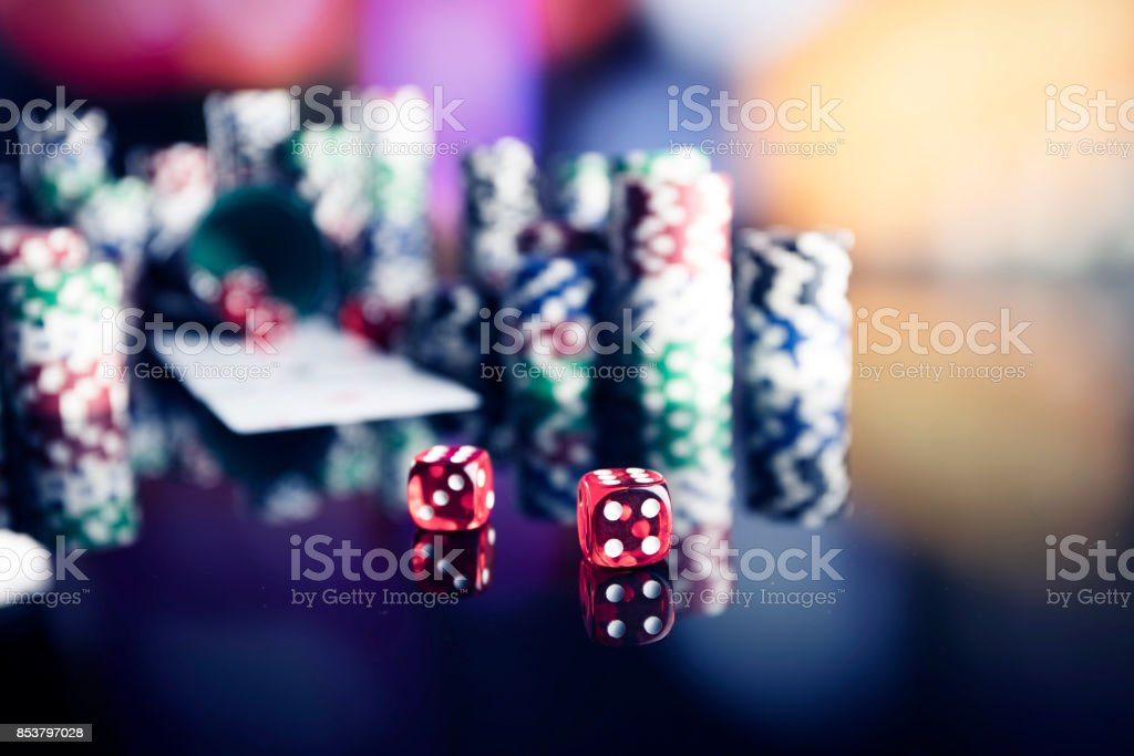 Casino theme. High contrast image of casino roulette, poker game,...