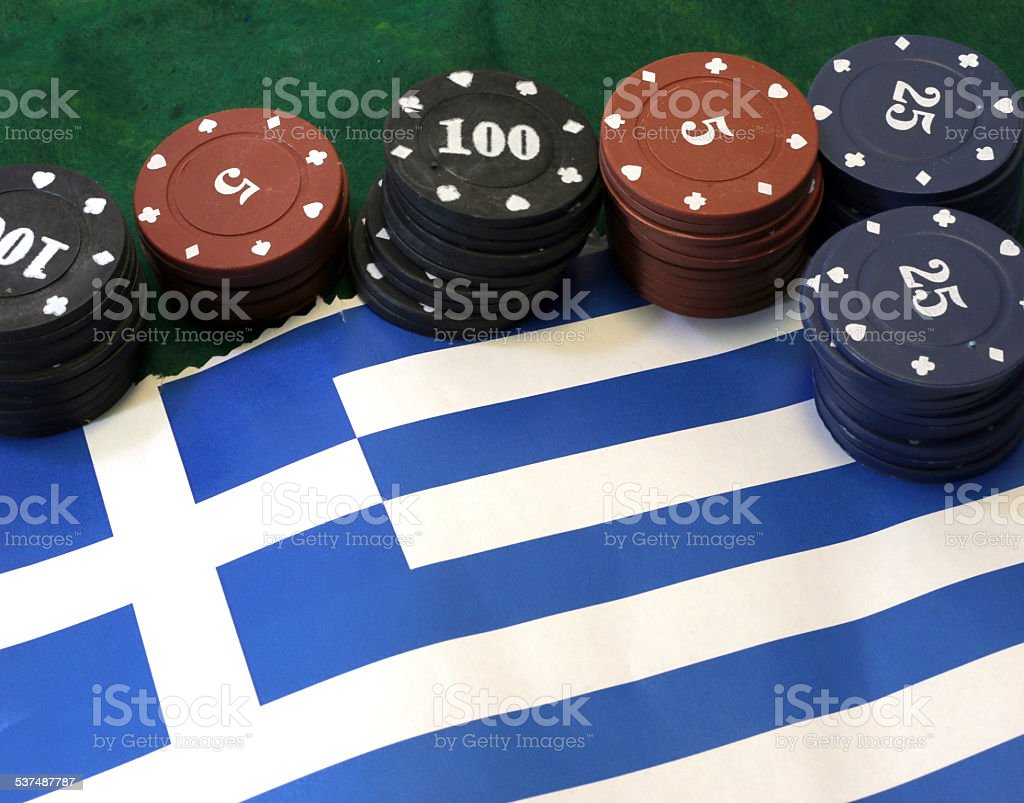 casino tokens for gambling over the flag of Greece stock photo