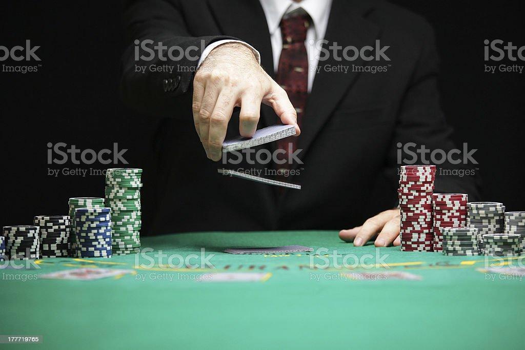 casino worker shuffling cards stock photo