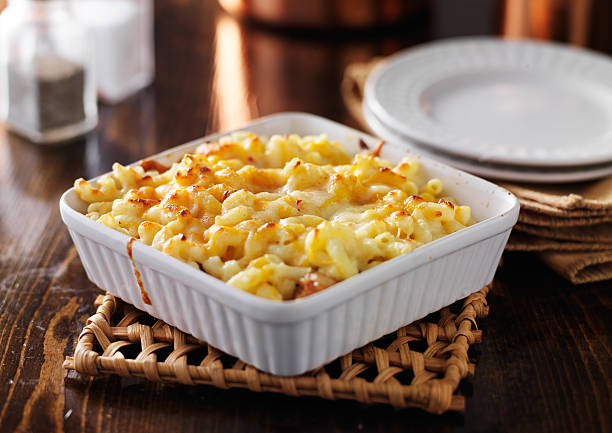 casserole dish with baked macaroni and cheese casserole dish with baked macaroni and cheese macaroni stock pictures, royalty-free photos & images