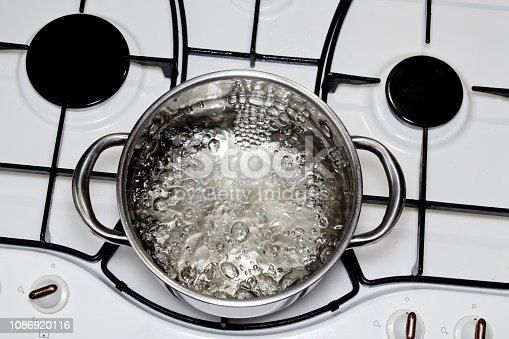 casserole with boiling water on the stove
