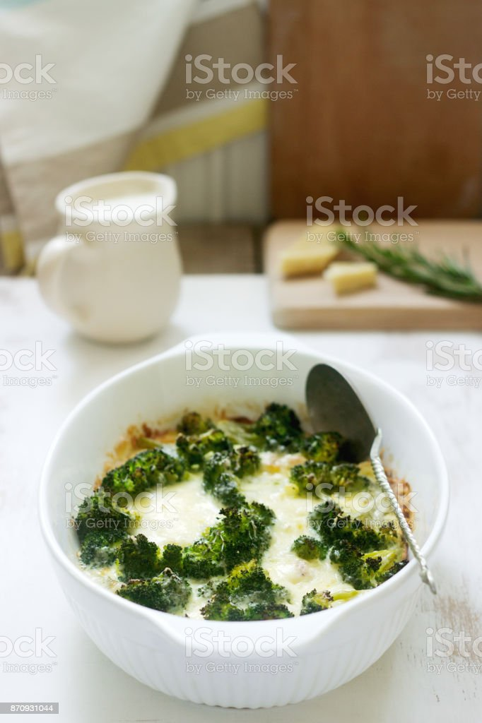 Casserole with broccoli, cauliflower and cheese on a light background. stock photo