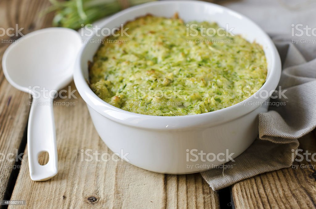Casserole with cheese and wild garlic stock photo