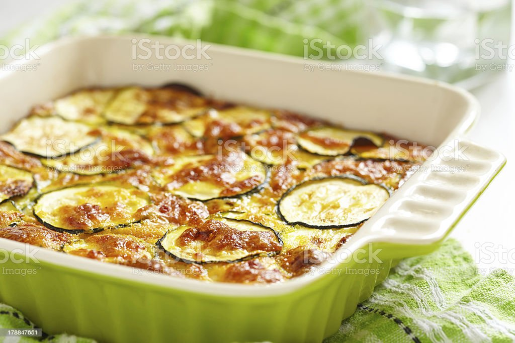 casserole with cheese and zucchini in baking dish stock photo