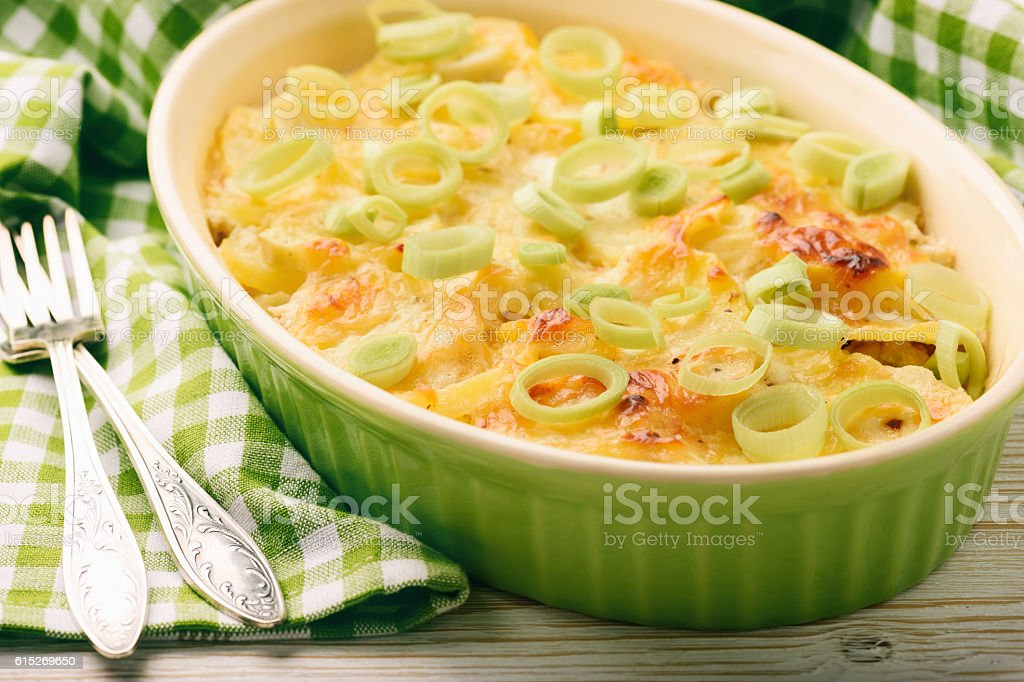 Casserole with chicken, potatoes, leek and cheese. stock photo