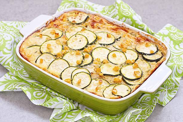casserole with zucchini, corn and potato in baking dish - käse zucchini backen stock-fotos und bilder