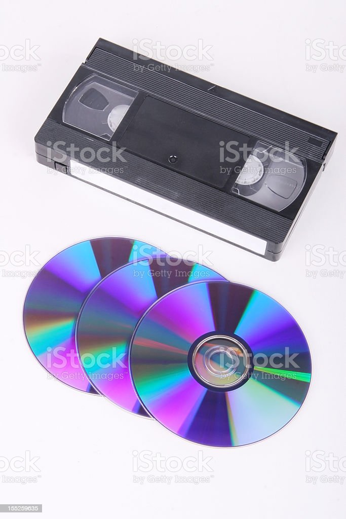 VHS cassette and CD discs on white background royalty-free stock photo