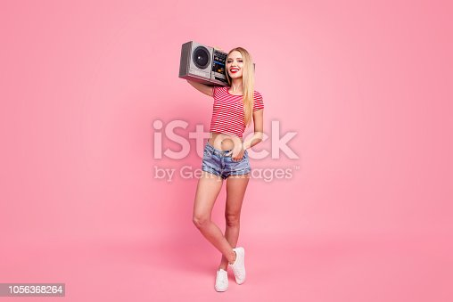 Cassette rap music battle melody rock person people concept. Full length size body studio photo portrait of beautiful cheerful excited lady posing with boombox on shoulder isolated background