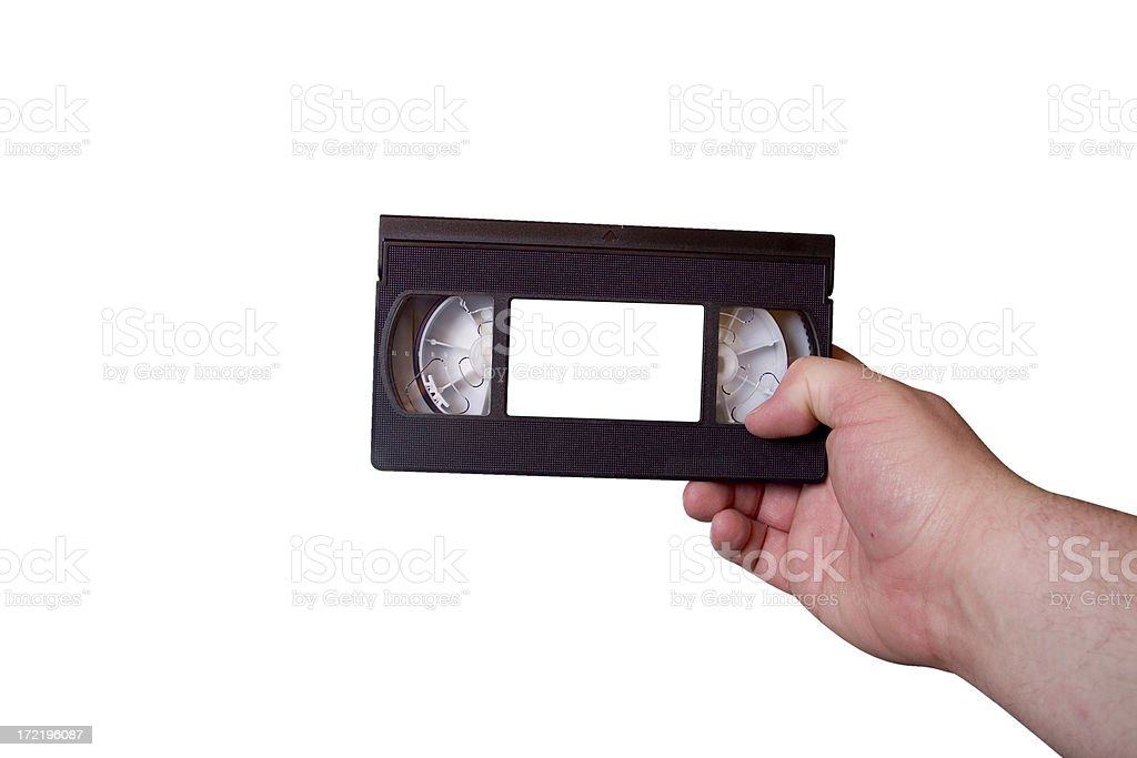 VHS cassette tape in right hand royalty-free stock photo