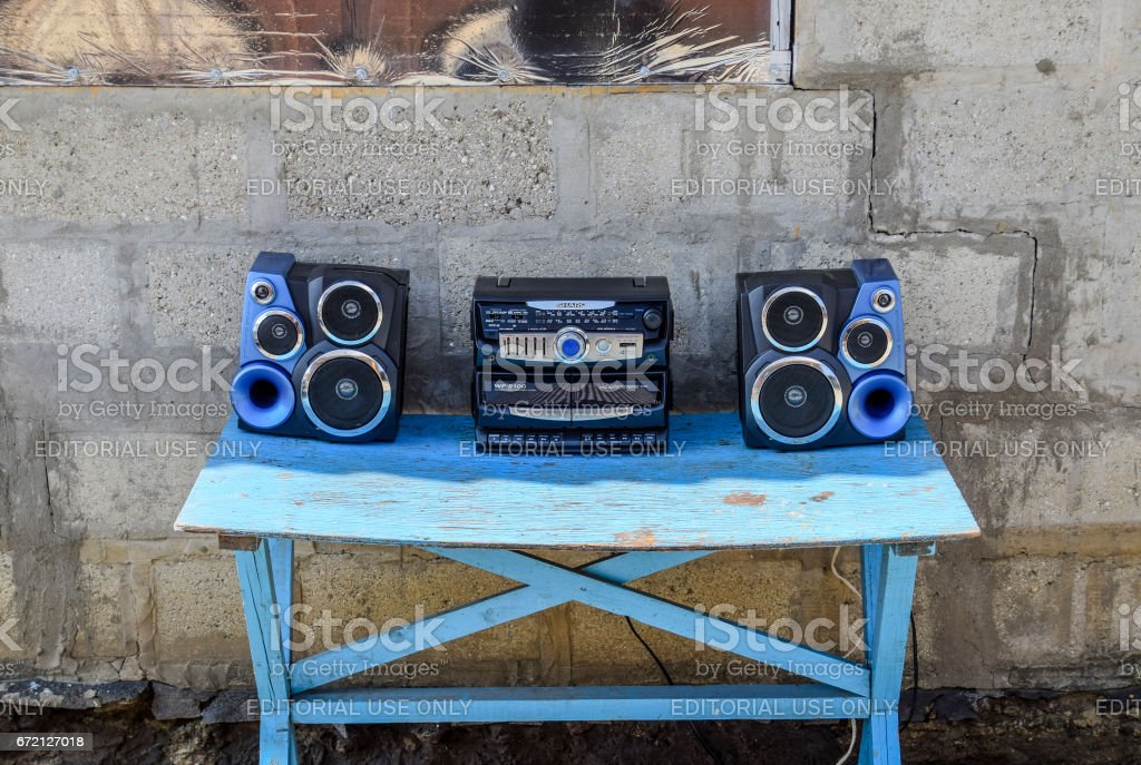 Cassette tape recorder with radio on a blue wooden table. Vintag stock photo