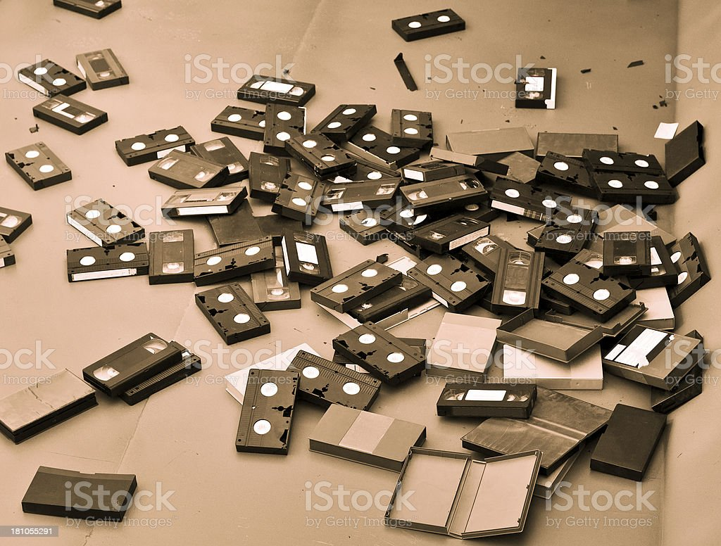 VHS Cassettes Thrown In Rubbish Skip, Sepia Toned stock photo