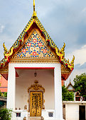 Classical Thai  architecture in Wat Pho public temple, Bangkok, Thailand. Wat Pho known also as the Temple of the Reclining Buddha.