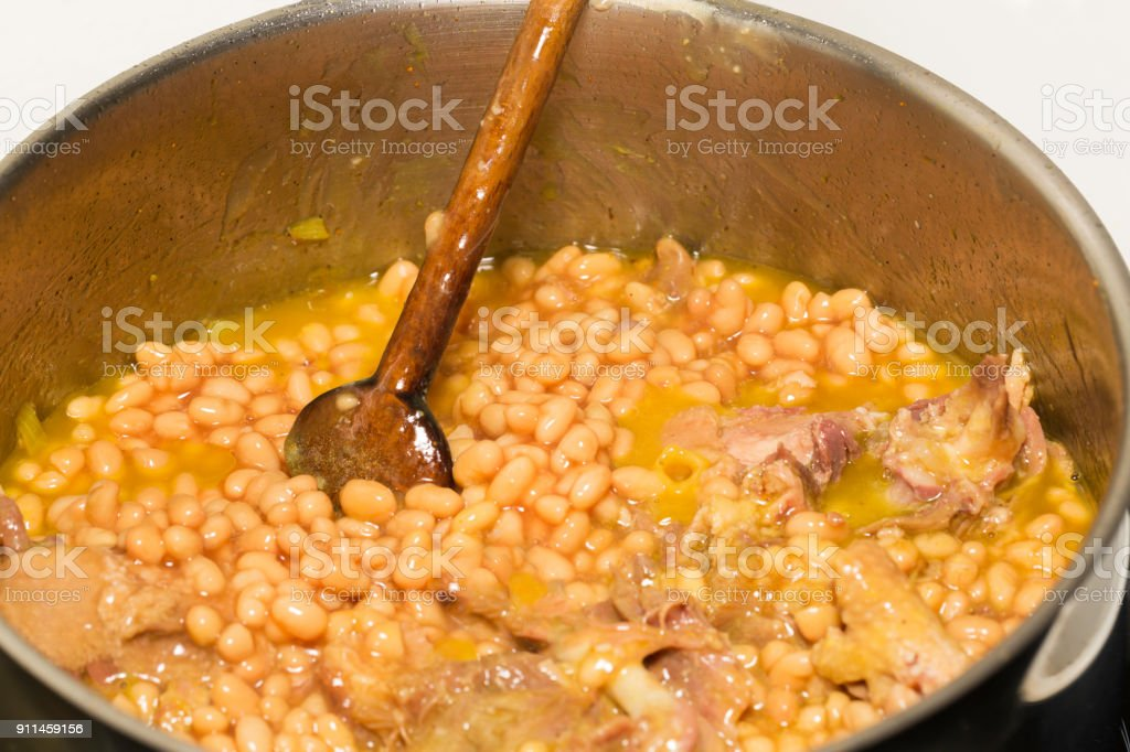 Cassoulet : Homemade Cassoulet is a French specialty of southern France, the best known city preparing cassoulet is Castelnaudary. In this picture, homemade Cassoulet. Baked Stock Photo