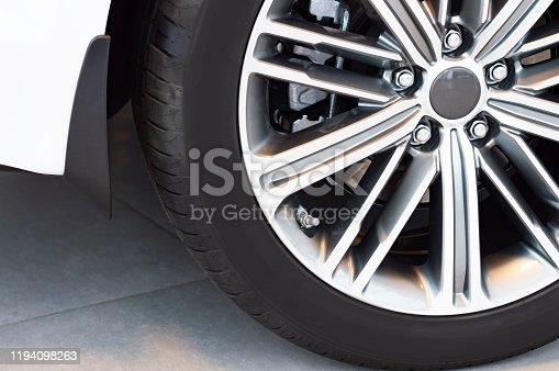907671144istockphoto Cast beautiful aluminum rim. Close up. 1194098263