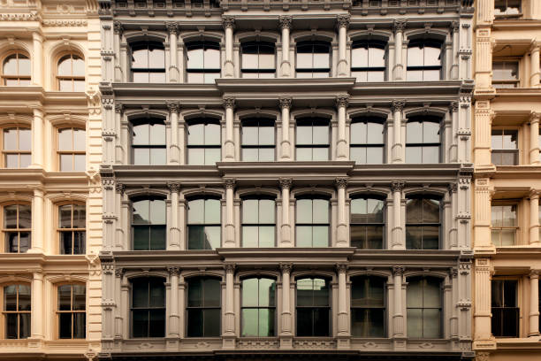 Cast Iron Buildings in Soho New York City Cast iron loft buildings in the Soho neighborhood of downtown Manhattan, New York City. soho new york stock pictures, royalty-free photos & images