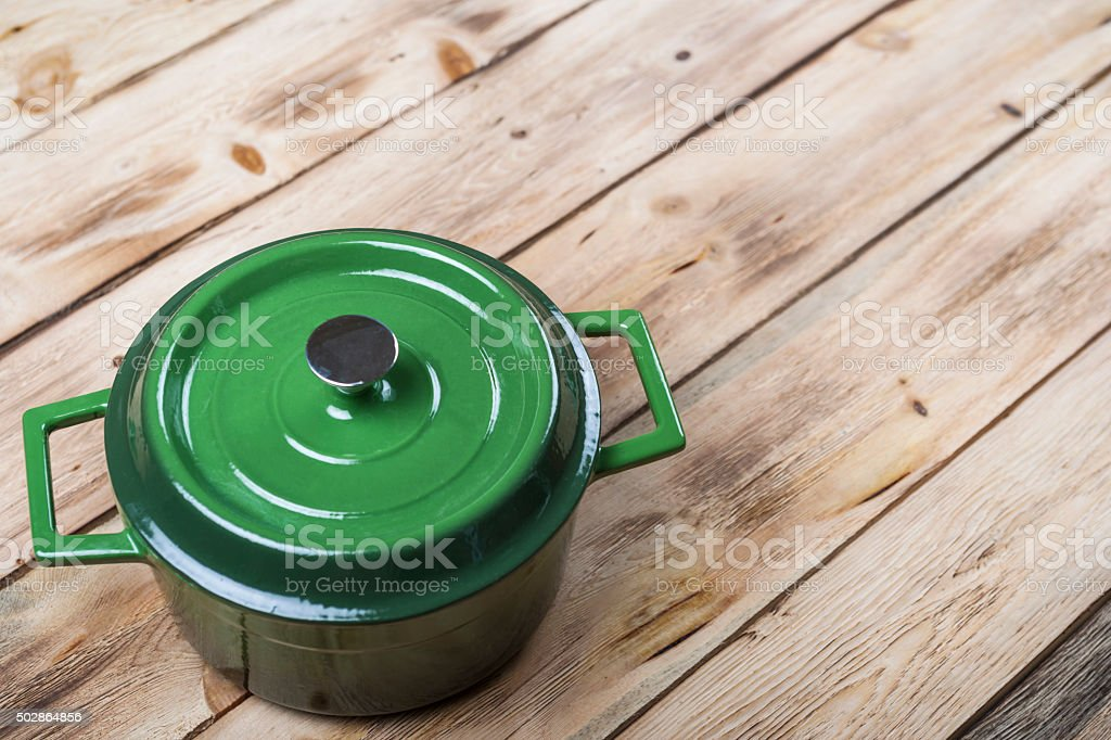 Cast Iron Casserole On Wooden Table stock photo