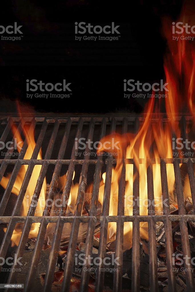 BBQ cast iron grate and Burning Fire XXXL stock photo
