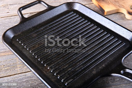 Cast iron griddle pan on wooden table