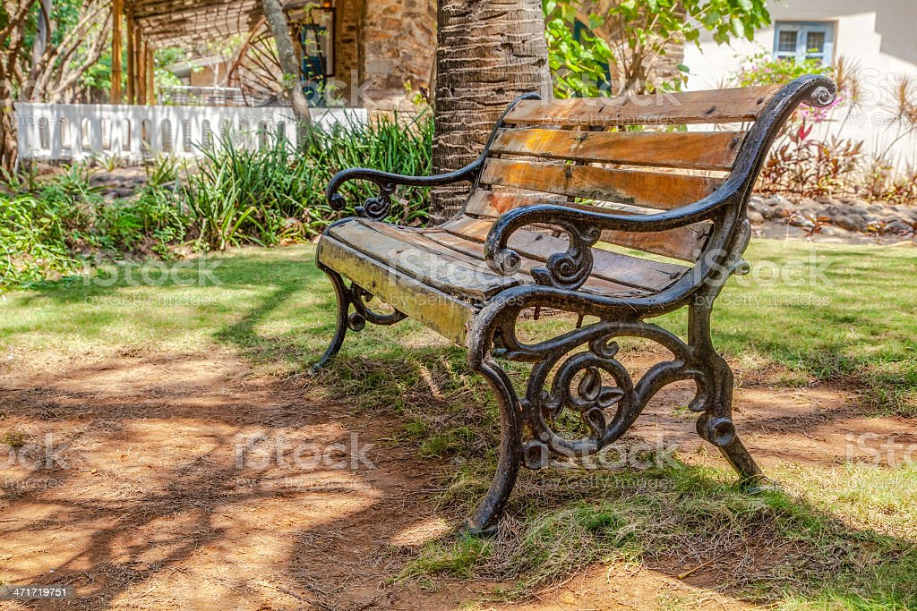 Cast iron wood slatted bench garden shade.CR2 royalty-free stock photo