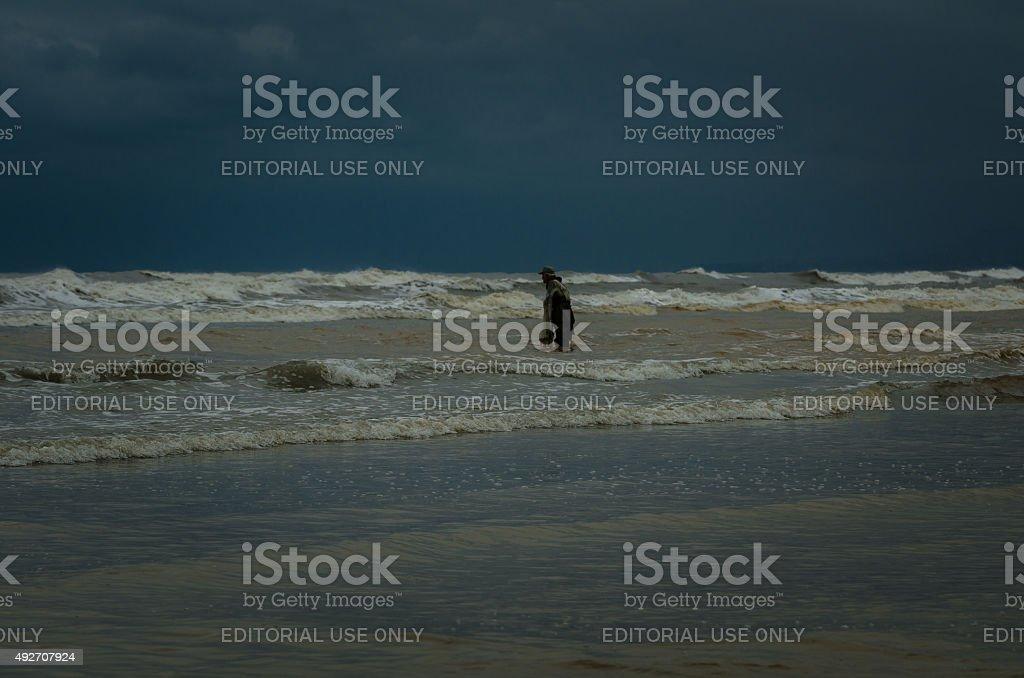 Cast net fishing on Black Sea stock photo