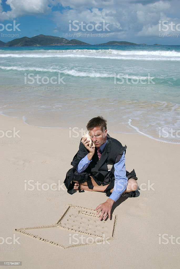 Castaway Businessman Multitasking Working on the Beach royalty-free stock photo