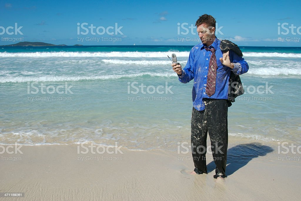 Castaway Businessman Standing Texting on Flip Phone royalty-free stock photo
