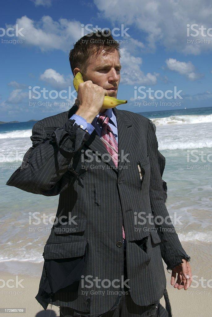 Castaway Businessman Stands Talking on Banana Phone stock photo