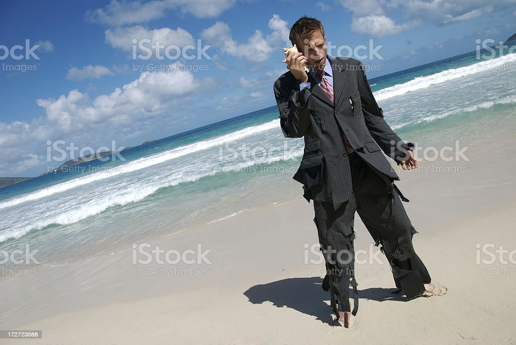 Castaway Businessman Stands Talking on Mobile Shell Phone royalty-free stock photo