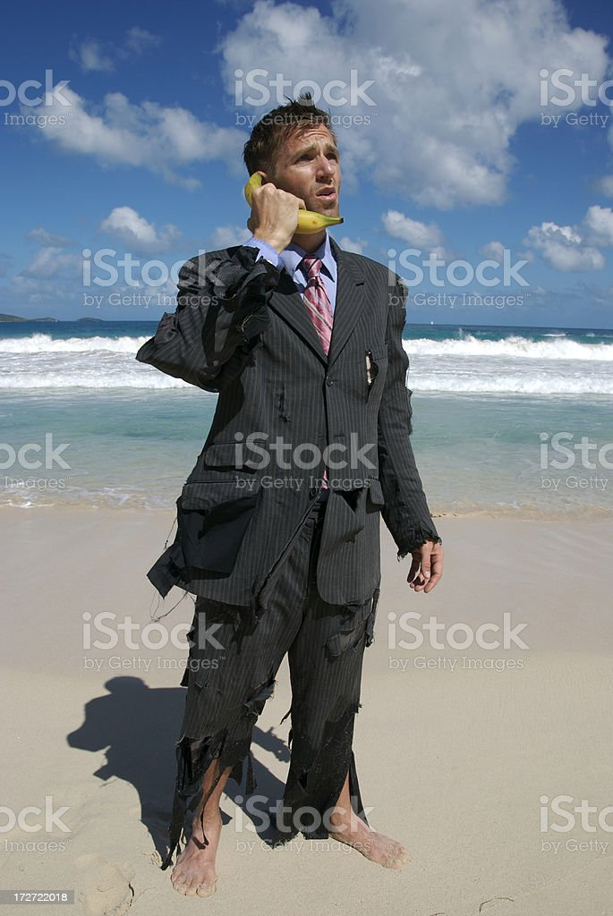 Castaway Businessman Talks on Mobile Banana Phone royalty-free stock photo