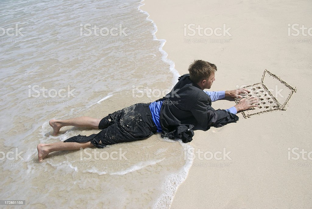Castaway Businessman Typing on Sand Laptop in Waves royalty-free stock photo