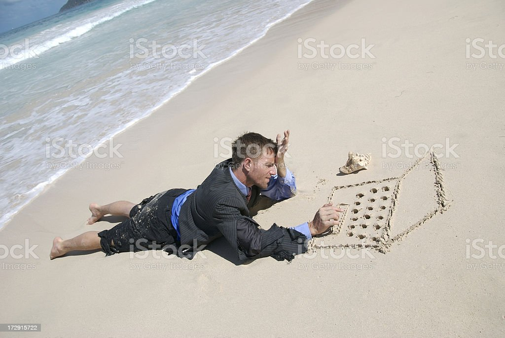 Castaway Businessman Working on Sand Laptop royalty-free stock photo
