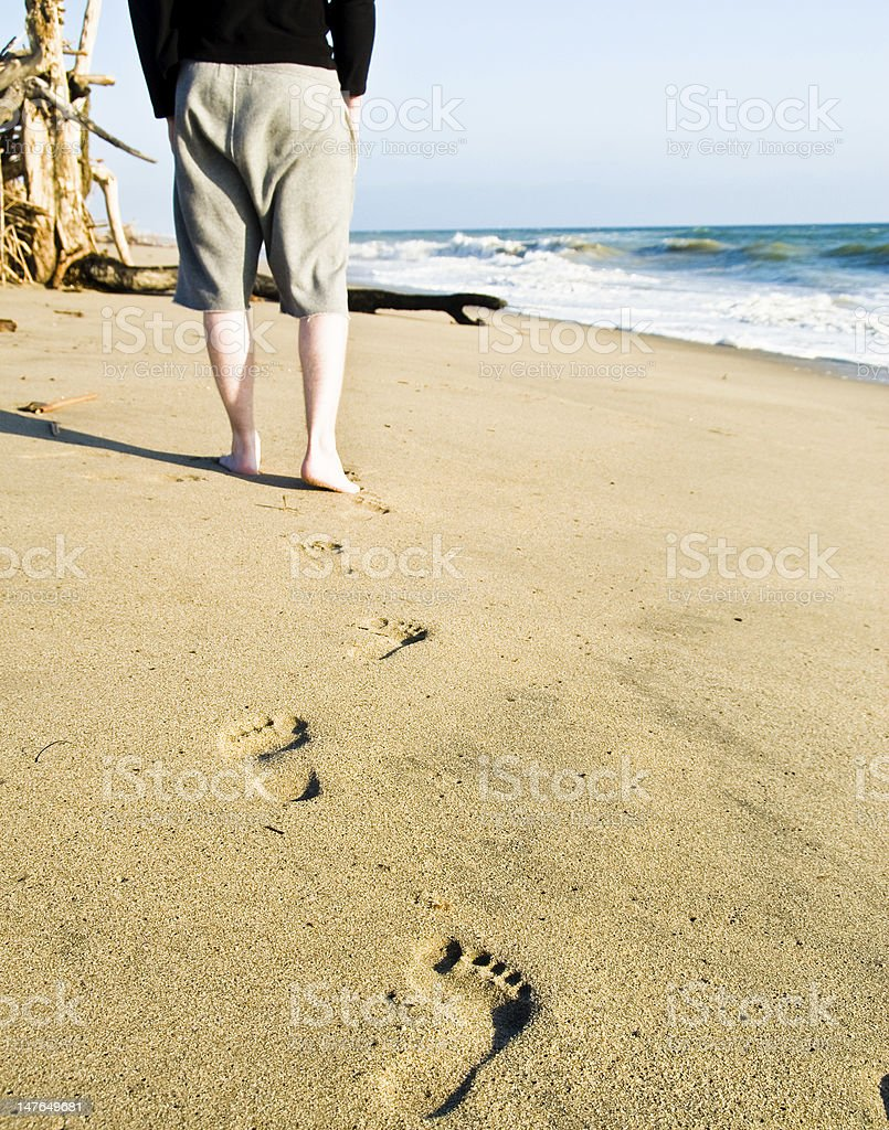 Castaway walking to his shelter - Beach Series royalty-free stock photo