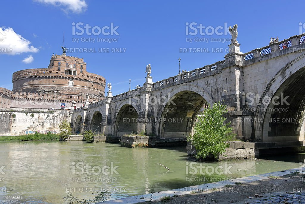 Castel Sant'Angelo and arches of the bridge across the river stock photo