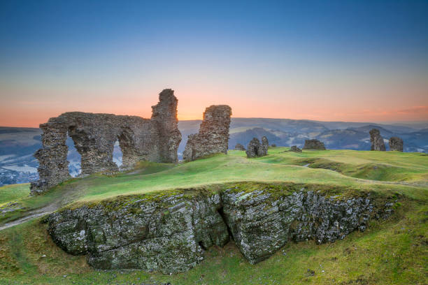 Castell Dinas Bran, Crow Castle,  Llangollen The Castell Dinas Bran, or Crow Castle in English, in Wales at sunset. These ancient ruins are all is left of a mighty castle that once stood on top of the hillside near the city of Llangollen, Wales, UK. wales stock pictures, royalty-free photos & images