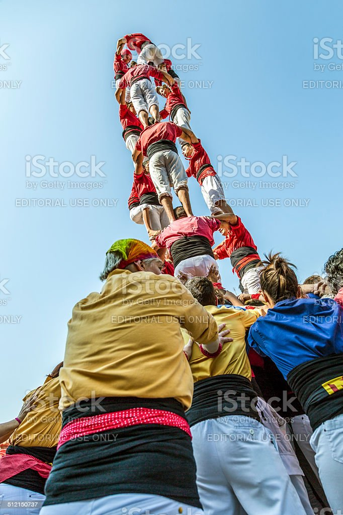 Castellers do a Castell or Human Tower, typical  in Catalonia. stock photo