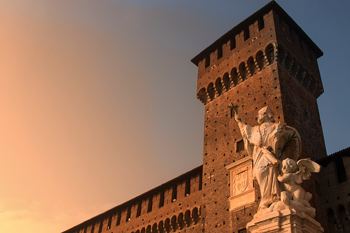 Castello Sforzesco, Milan, Italy. Castle at sunset. Beautiful statue