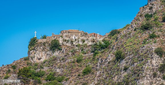 Castelmola as seen from the Taormina ancient theater, Sicily Italy.
