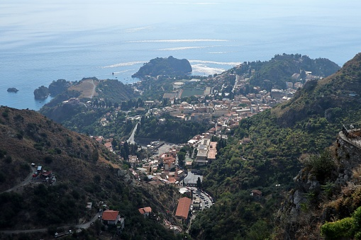 Castelmola, Sicily, Italy - August 28, 2020: Panorama of Taormina from the lookout of Piazza Sant'Antonio