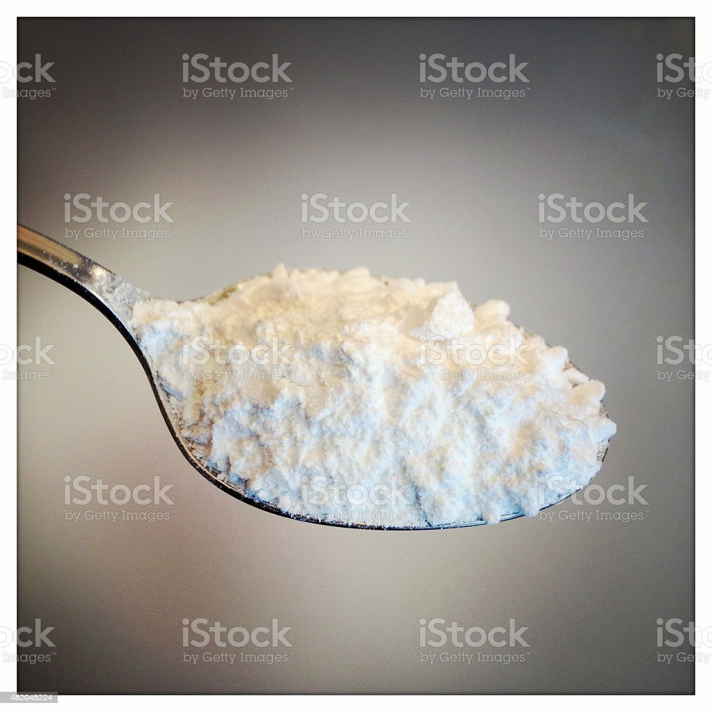 Caster Sugar on spoon stock photo