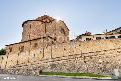 Castiglione del Lago, Italy Medieval fortress fort wall in Umbria in sunny summer day cityscape with church tower entrance low angle view with sun in sky