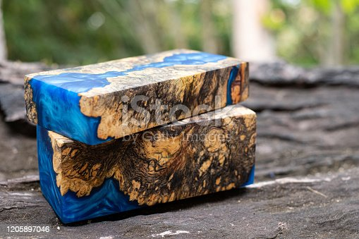 527567107 istock photo Casting epoxy resin burl wood cube on old table art background, Nature Afzelia wooden 1205897046