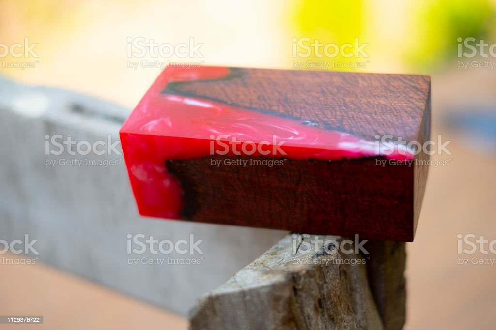 Casting Epoxy Resin Stabilizing Wood Has Tiger Stripe Red Color